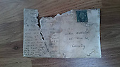 80-year-old postcard stashed between floor tiles