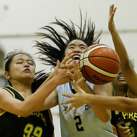 (#2) of Singapore Institute of Management is fouled on the drive by (#99) of Singapore Polytechnic. (Photo © Lim Yong Teck/Red Sports)
