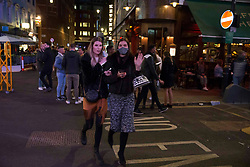 © Licensed to London News Pictures.  01/05/2021. London, UK. Members of the public make the most of Saturday night out in Soho, central London.  Photo credit: Marcin Nowak/LNP