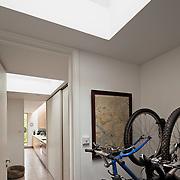 view of hallway into kitchen with bike rack
