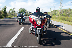 Motorcycle Racer Carey Hart riding a personally customized red Indian Chieftain Elite with Marc Altieri (l) and Bagger Magazine's Morgan Gales (r) riding 2017 Indian Chieftains on I-95 during Daytona Beach Bike Week. FL, USA. Friday March 10, 2017. Photography ©2017 Michael Lichter.
