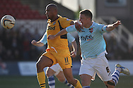 Chris Zebroski of Newport battles for the ball against Danny Coles of Exeter (r). Skybet football league two match, Newport county v Exeter city at Rodney Parade in Newport, South Wales on Sunday 16th March 2014.<br /> pic by Mark Hawkins, Andrew Orchard sports photography.