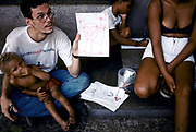 Brazil - Rio de Janeiro - A social worker educates street children how to draw as part of a education designed to attempt to recover these poor homeless and familyless children off the streets of Rio de Janeiro, Brazil