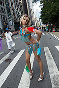 A young cross-dresser poses on the parade route.