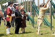 Belgian Crown Prince Filip and Dutch Queen Beatrix attend the 100 years' jubilee of the Old Limburgs Citizens Soldiers in Stramproy, in southern Netherlands near the Belgian border.<br /> <br /> Hare Majesteit de Koningin en Zijne Koninklijke Hoogheid Prins Filip van België bezoeken het 100-jarig jubileum van  het Oud Limburgs Schuttersfeest in Stramproy. Honderd jaar geleden vond voor het eerst een schuttersevenement plaats onder de naam Oud Limburgs Schuttersfeest. Het is een jaarlijks evenement waaraan ruim 160 schutterijen uit zowel Nederlands als Belgisch Limburg deelnemen. <br /> <br /> On the photo / Op de foto: <br /> <br />  Dutch Queen Beatrix looks on as Belgian crownprince Filip tries an old gun / Beatrix kijkt toe als Filip een poging waagt tijdens het koningsschieten.