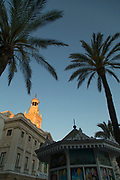 Low angle view of town hall with palm trees in foreground, Cadiz, Andalusia, Spain
