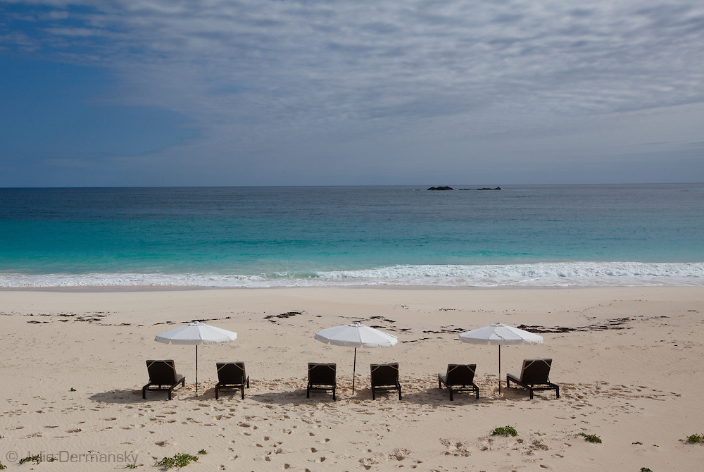 Beach chairs with umbrellas at Serenity Point, Abaco, Bahamas