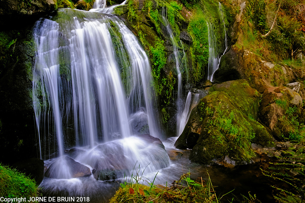 A waterfall in the Black Forest at Triberg ends in a small pool in the forest.
