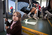 28 DECEMBER 2008 -- PHOENIX, AZ: AYLA DeVOLL, 3, from Phoenix, rides the new Metro train in Phoenix, AZ, Sunday. The new Metro Light Rail is 20 miles long and cost $1.4 billion dollars. Construction was funded by local, state and federal monies. The trains will operate on one line through Phoenix and the suburban communities of Tempe and Mesa. The trains started running Saturday, Dec 27, 2008 and will be free until Jan. 1, 2009. The regular fare will be $1.25 for one ride or $2.50 for an all day pass.  Photo by Jack Kurtz / ZUMA Press