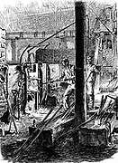 Puddling furnace and mechanical hammer (right background): Pig iron puddled to remove carbon and oxygen, ball of hot metal (bloom) then hammered. Process sometimes repeated. Purest form of iron with great strength produced. Krupps Works, Essen, Germany. Wood engraving, Leipzig, c1895.