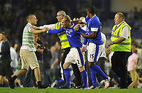 Football - Pre-Season Friendly - Everton vs. AEK Athens<br /> Everton's Tony Hibbert scores and the pitch gets invaded