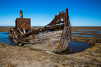Landscape, abandoned boat on shore. <br />