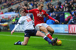 Luke Freeman of Bristol City is tackled by Josh Vela of Bolton Wanderers - Mandatory byline: Dougie Allward/JMP - 07966 386802 - 07/11/2015 - FOOTBALL - Macron Stadium - Bolton, England - Bolton Wanderers v Bristol City - Sky Bet Championship
