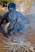 Hadzabe hunter at the fireplace. Lake Eyasi, northern Tanzania.