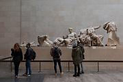 Visitors learn about the British Museums Elgin Marbles that originate from the Parthenon in Athens, on 28th February 2017, in London, England.