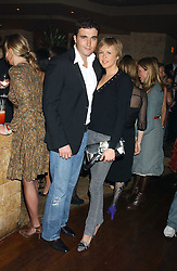 LADY ALEXANDRA SPENCER-CHURCHILL and DAVID PEACOCK at a party hosted by Daniella Helayel of fashion label ISSA held at Taman Gang, 141 Park Lane, London on 15th February 2006.<br />