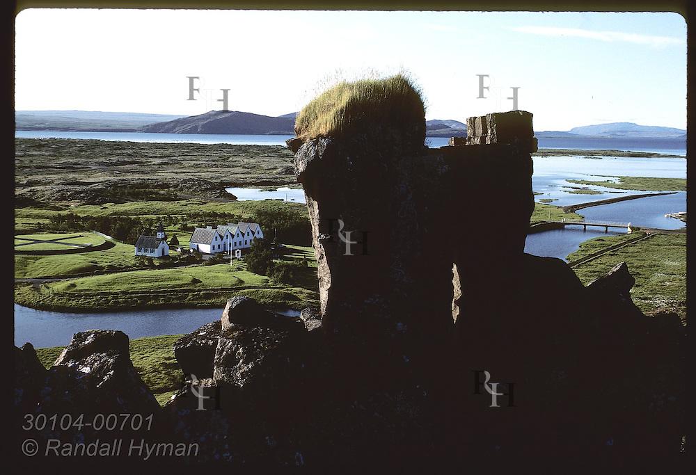 Basalt pillars stand guard over Thingvellir parsonage, first site of world's oldest parliament. Iceland