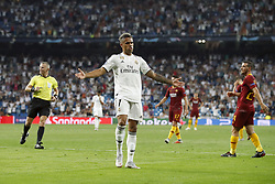 (L-R) referee Bjorn Kuipers, Mariano Diaz of Real Madrid, Cengiz Under of AS Roma, Alessandro Florenzi of AS Roma during the UEFA Champions League group G match between Real Madrid and AS Roma at the Santiago Bernabeu stadium on September 19, 2018 in Madrid, Spain