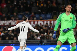 November 27, 2018 - Rome, Italy - Real Madrid's Welsh forward Gareth Bale (L) celebrates after opening the scoring as AS Roma Swedish goalkeeper Robin Olsen reacts during the Champions league football match between AS Roma  and Real Madrid at Olimpico stadium in Rome, Italy, on November 27, 2018. (Credit Image: © Federica Roselli/NurPhoto via ZUMA Press)