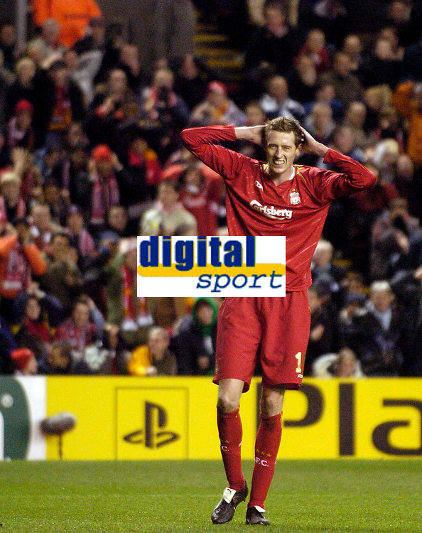 Photo: Jed Wee.<br /> Liverpool v Benfica. UEFA Champions League. 08/03/2006.<br /> <br /> Liverpool's Peter Crouch rues a missed opportunity.