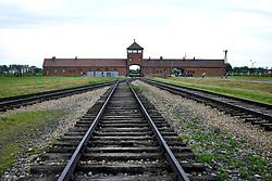 Auschwitz-Birkenau former concentration camp is seen through barbed wire