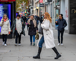 © Licensed to London News Pictures. 26/11/2020. London, UK. Christmas shoppers in Oxford Street, London as Health Secretary Matt Hancock reveals his plans today for a new Covid 3 tiered system of restrictions. As expected, London escape the highest restriction of Tier 3 and will be in Tier 2 with the possibility of shops, pubs and restaurants to open up again for the Christmas period. Photo credit: Alex Lentati/LNP