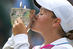LONDON, ENGLAND - Sunday, July 3, 2011: Ashleigh Barty (AUS) celebrates by kissing the trophy after winning the Girls' Singles Final match on day thirteen of the Wimbledon Lawn Tennis Championships at the All England Lawn Tennis and Croquet Club. (Pic by David Rawcliffe/Propaganda)