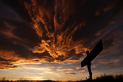 The sun sets behind the Angel of the North in Gateshead, Tyne and Wear.
