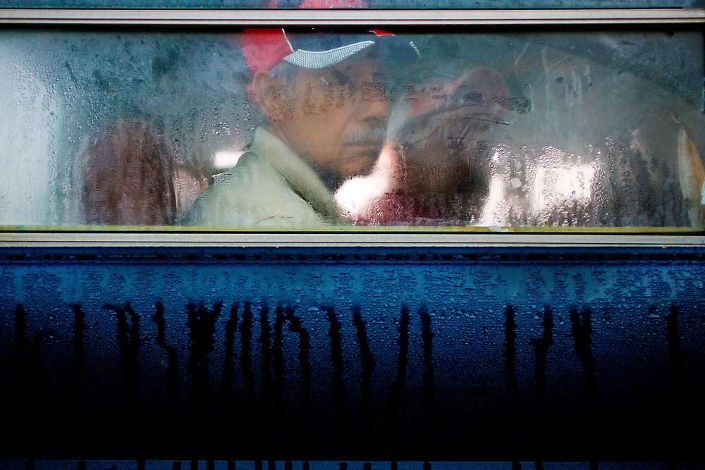 Carlos Romirez, 66, of Nayarit, Mexico rides the camp bus from his community house to work at Titan Farms in Ridge Spring, S.C. Romirez is married and has seven children, he has worked on the farm for twelve years.