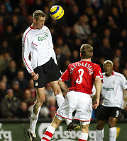 Photo: Chris Ratcliffe.<br /> Charlton Athletic v Liverpool. The Barclays Premiership. 08/02/2006.<br /> Peter Crouch of Liverpool climbs above Hermann Hreidarsson of Charlton