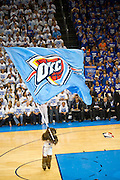 June 2, 2012; Oklahoma City, OK, USA; Oklahoma City Thunder mascot Rumble the Bison runs through the arena with a flag during a playoff game against the San Antonio Spurs at Chesapeake Energy Arena.  Thunder defeated the Spurs 109-103 Mandatory Credit: Beth Hall-US PRESSWIRE