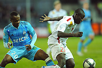 FOOTBALL - FRENCH CHAMPIONSHIP 2010/2011 - L1 - STADE BRESTOIS v OLYMPIQUE MARSEILLE - 22/12/2010 - PHOTO PASCAL ALLEE / DPPI - OUSMANE COULIBALY (BREST) / ANDRE AYEW (OM)