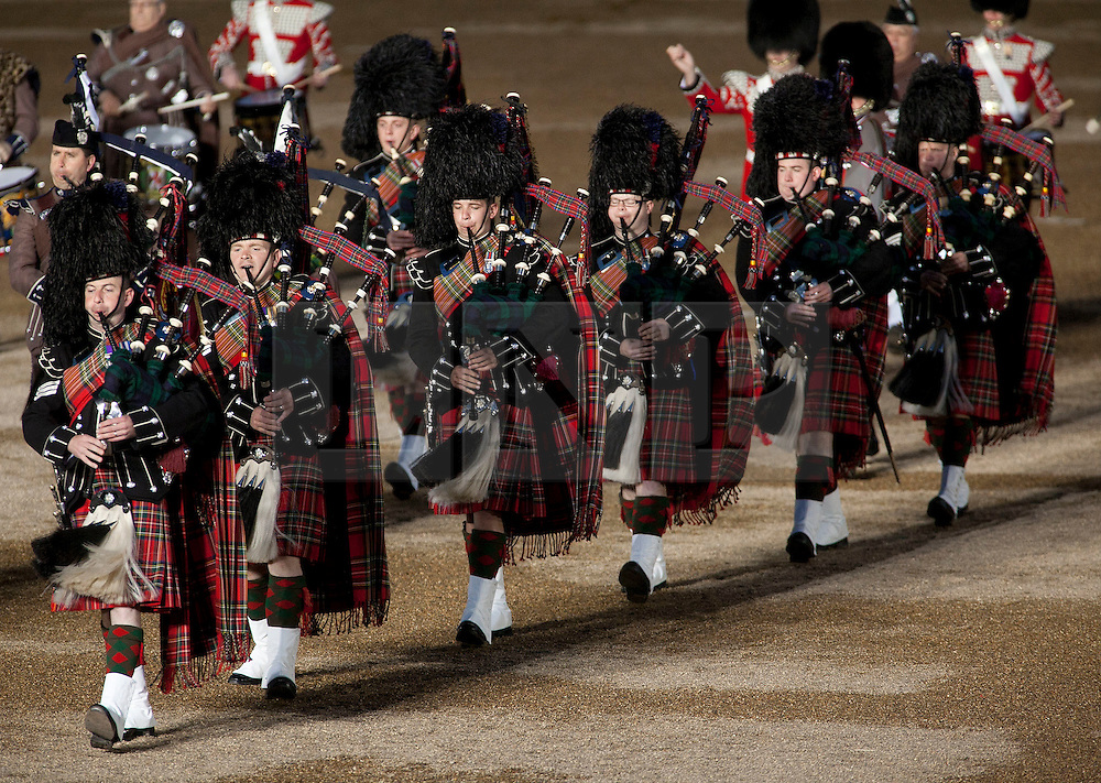 © Licensed to London News Pictures. LONDON, UK  09/06/11. British Army pipers march in formation as they perform at the annual Beating of the Retreat at Horse Guards Parade. On two successive evenings each year in June a pageant of military music, precision drill and colour takes place on Horse Guards Parade in the heart of London when the Massed Bands of the Household Division carry out the Ceremony of Beating Retreat. 300 musicians, drummers and pipers perform this age-old ceremony. The Retreat has origins in the early days of chivalry when beating or sounding retreat pulled a halt to the days fighting. Please see special instructions. Photo credit should read Matt Cetti Roberts/LNP. Please see special instructions for usage rates. Photo credit should read Matt Cetti-Roberts/LNP