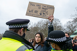 © Licensed to London News Pictures. 20/03/2021. London, UK. Police attempt to engage with a woman at Speakers Corner during the anti-lockdown demonstration 'Worldwide Rally For Freedom' held in central London. Photo credit: Peter Manning/LNP