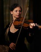 Portrait of Polinka Shylo with violin on the Celebrity Reflection.