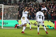 Jordan Ayew of Swansea city (c) celebrates with his teammates after he scores his teams 1st goal to make it 1-1.  Premier league match, Swansea city v Crystal Palace at the Liberty Stadium in Swansea, South Wales on Saturday 23rd December 2017.<br /> pic by  Andrew Orchard, Andrew Orchard sports photography.