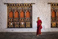 PUNAKHA, BHUTAN - CIRCA October 2014: Monk walking in the Punakha Dzong, a landmark in Punakha, Bhutan