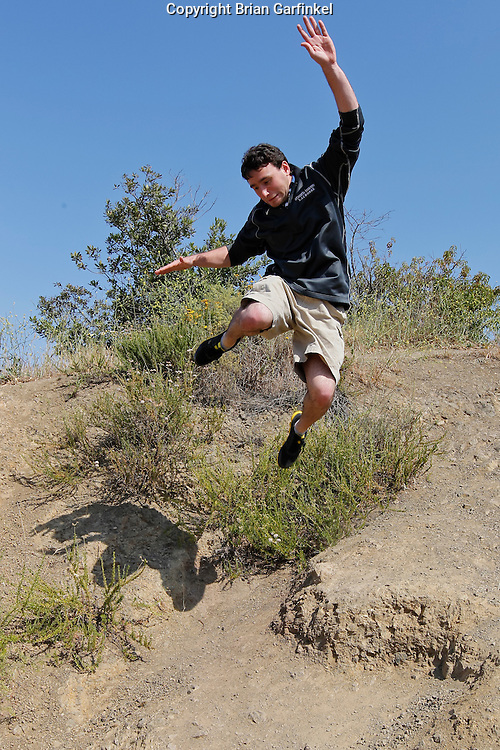 Joel jumps off of a cliff at The Observatory in Griffith Park, Los Angeles on Saturday, May 9th, 2011.