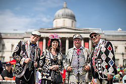 © Licensed to London News Pictures. 21/04/2018. London, UK. 'Pearly Kings and Queens' attend the 'Feast of St George' event in Trafalgar Square, to celebrate the Patron Saint of England. St George's Day is on 23 April. Photo credit : Tom Nicholson/LNP