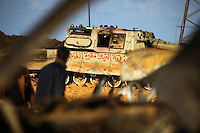 """""""The Toreyah district is a cemetery..."""" ays graffiti written on the side of a tank belonging to pro-Ghaddafi forces bombed at a staging area outside Benghazi that was devastated by coalition forces enforcing the no-fly zone over eastern Libya"""