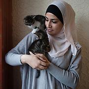 Arhus, Denmark, May 8, 2010. Isra, Palestian girl 16 years old in her room.