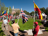 Fifty one flags representing fifty one countries marched down Beacon Street to Rotary Park Saturday to begin the 10th annual Multicultural Market Day festivities on Saturday.  (Karen Bobotas/for the Laconia Daily Sun)Multicultural Market Day in Laconia.  (Karen Bobotas/for the Laconia Daily Sun)
