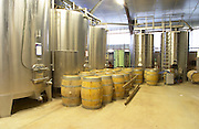 stainless steel fermentation tanks and barriques Chateau Belingard Bergerac Dordogne France