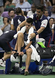 September 5, 2018 - Flushing Meadows, New York, U.S - Novack Djokovic changes clothing after an invocation of the 'Equipment Out of Adjustment'  due to excessive sweat on the court during his match against John Millman on Day 10 of the 2018 US Open at USTA Billie Jean King National Tennis Center on Wednesday September 5, 2018 in the Flushing neighborhood of the Queens borough of New York City. Novack Djokovic defeats Millman, 6-3, 6-4, 6-4. (Credit Image: © Prensa Internacional via ZUMA Wire)