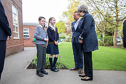 © Licensed to London News Pictures . 30/04/2018. Manchester , UK. British Prime Minister THERESA MAY visits Brooklands Primary School in Sale , greeted by LUKE and CORAL (head boy and head girl) and head master MATTHEW COPPING (2nd right) . May is facing questions over her role in the scandal of the way Windrush migrants have been treated and after the resignation of Home Secretary, Amber Rudd, late last night (29 April 2018) . Photo credit : Joel Goodman/LNP