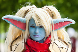 "© Licensed to London News Pictures. 29/05/2016. London, UK. A girl dresses as ""Poppy"" from the game, League of Legends, as cosplayers visit the Excel Centre on the last day of the popular MC Comic Con, a three day event celebrating games, anime, movies and more. Photo credit : Stephen Chung/LNP"