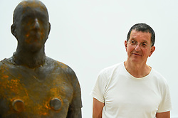 "© Licensed to London News Pictures. 16/09/2019. LONDON, UK.  Antony Gormley RA poses next to his work ""Lost Horizon I"", 2008, which comprises 24 cast iron body forms.  Preview of a new exhibition by Antony Gormley at the Royal Academy of Arts.  The show bring together existing and specially conceived new works from drawing to sculptures to experimental environments to be displayed in all 13 rooms of the RA's Main Galleries 21 September to 3 December 2019.  Photo credit: Stephen Chung/LNP"