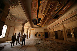 Mowfaq Al-Tai, an Iraqi architect, leads two U.S. soldiers through one of the rooms inside the now partially destroyed Salam Palace in Baghdad, Iraq, Sept. 29, 2003. According to Al-Tai, the Salam Palace is most representative of the design and architecture used in the hundreds of palaces built for Saddam Hussein. Al-Tai was one the the engineers involved in the construction and quality control of the Hussein palaces.