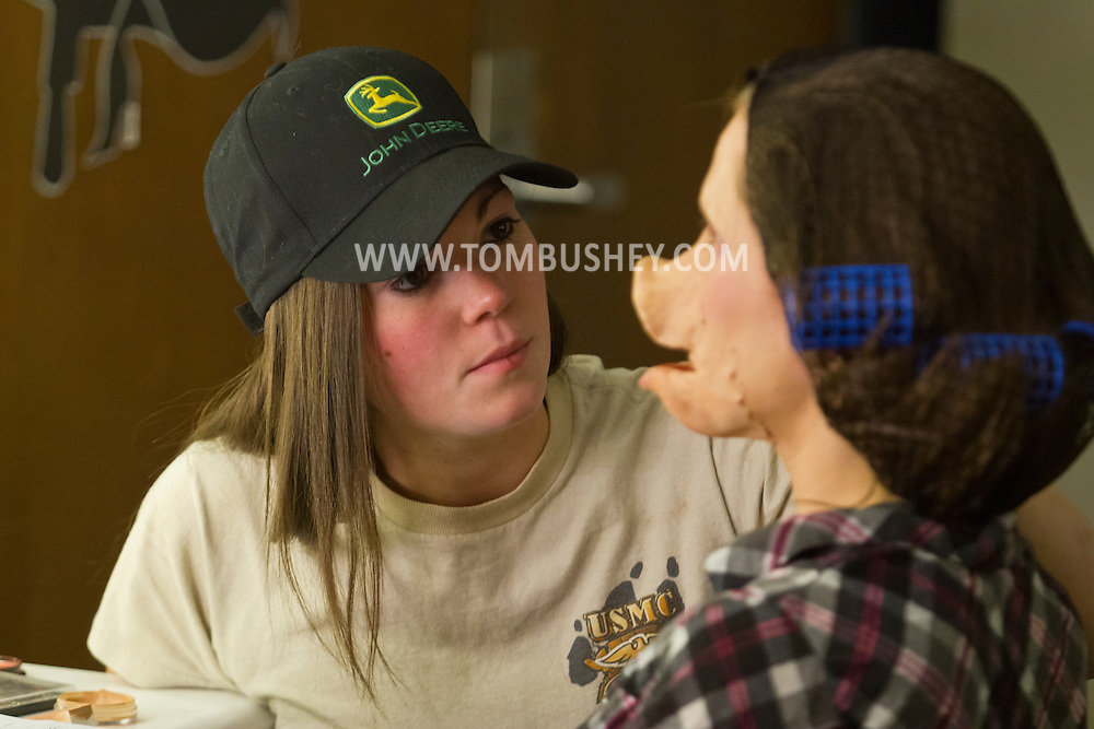 Middletown, New York - An actress from  the Apprentice Players of the SUNY Orange Arts & Communications Department has a mask and makeup applied before a  dress rehearsal at Orange Hall Theatre on April 17, 2014.