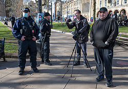 © Licensed to London News Pictures;03/07/2021; Bristol, UK. File Picture dated 26/03/2021 of CHRISTOPHER BATT (third from left without hat) who livestreams as Tyrant Finder UK, filming at the third Kill the Bill protest in Bristol against the Police, Crime, Sentencing and Courts Bill during the Covid-19 coronavirus pandemic in England. Christopher Batt is due at Westminster Magistrates Court on Saturday 03 July 2021 for non-payment of a fine he received for breaching covid lockdown laws after he was arrested in the Oxford Street area of London on 05 November 2020. He is a father-of-six from the Hartcliffe area of Bristol and livestreams anti-lockdown protests and police activity in Bristol and around the country on his YouTube 'Tyrant Finder UK' channel. He has asked for people to attend outside the court to support him and has appealed for legal advice and for others to livestream the event. Photo credit: Simon Chapman/LNP.
